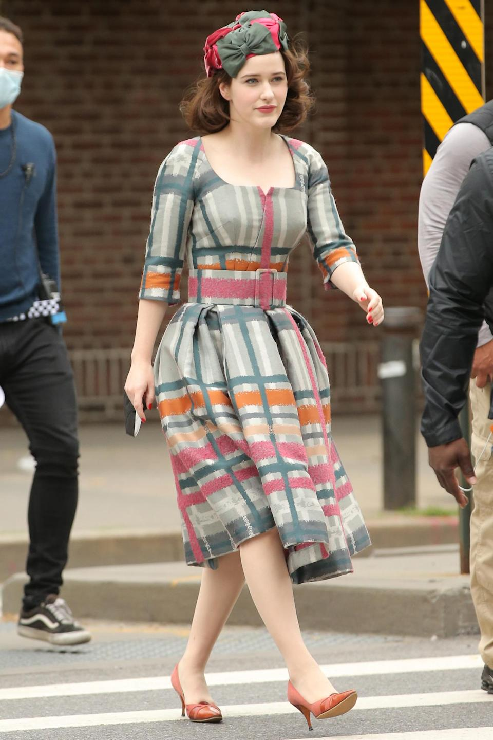 <p>Brosnahan films a scene in a plaid ensemble on May 26. </p>