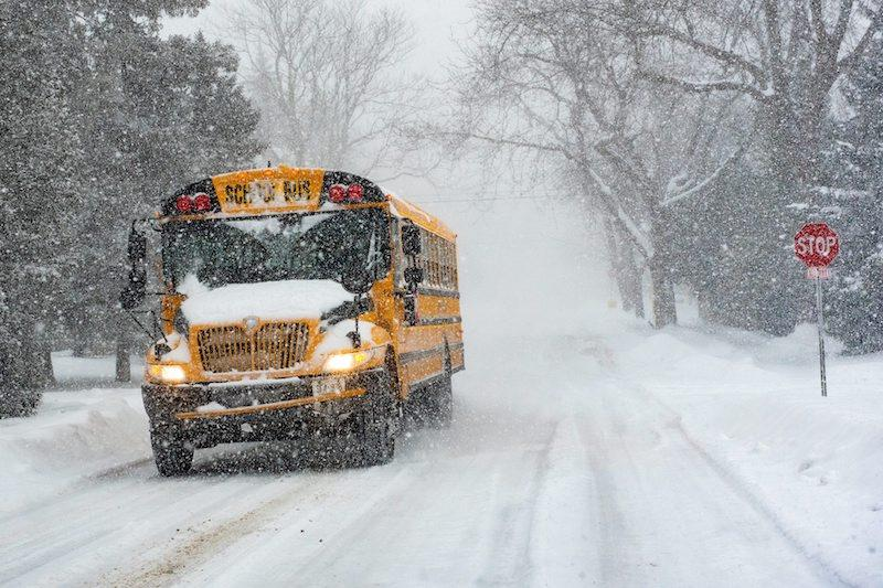 <p>A school bus travels on snow-covered roads in northern Toronto as snow falls on Jan. 28, 2019. Photo from The Canadian Press. </p>