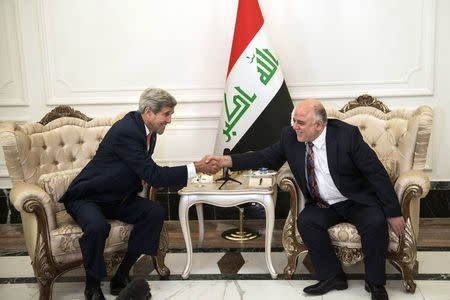 U.S. Secretary of State John Kerry (L) and new Iraqi Prime Minister Haider Abadi shake hands after a meeting in Baghdad September 10, 2014. REUTERS/Brendan Smialowski/Pool