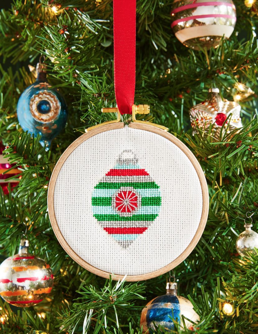 """<p>If you're crafty, now's the time to show it off! Stitch this adorable Christmas motif, and let your recipient share your handiwork with the world year after year after year.</p><p><strong><a href=""""https://www.countryliving.com/diy-crafts/a6380/cross-stitch/"""" rel=""""nofollow noopener"""" target=""""_blank"""" data-ylk=""""slk:Get the tutorial."""" class=""""link rapid-noclick-resp"""">Get the tutorial.</a></strong></p><p><a class=""""link rapid-noclick-resp"""" href=""""https://www.amazon.com/Best-Sellers-Arts-Crafts-Sewing-Embroidery-Hoops/zgbs/arts-crafts/262621011?tag=syn-yahoo-20&ascsubtag=%5Bartid%7C10050.g.645%5Bsrc%7Cyahoo-us"""" rel=""""nofollow noopener"""" target=""""_blank"""" data-ylk=""""slk:SHOP EMBROIDERY HOOPS"""">SHOP EMBROIDERY HOOPS</a></p>"""