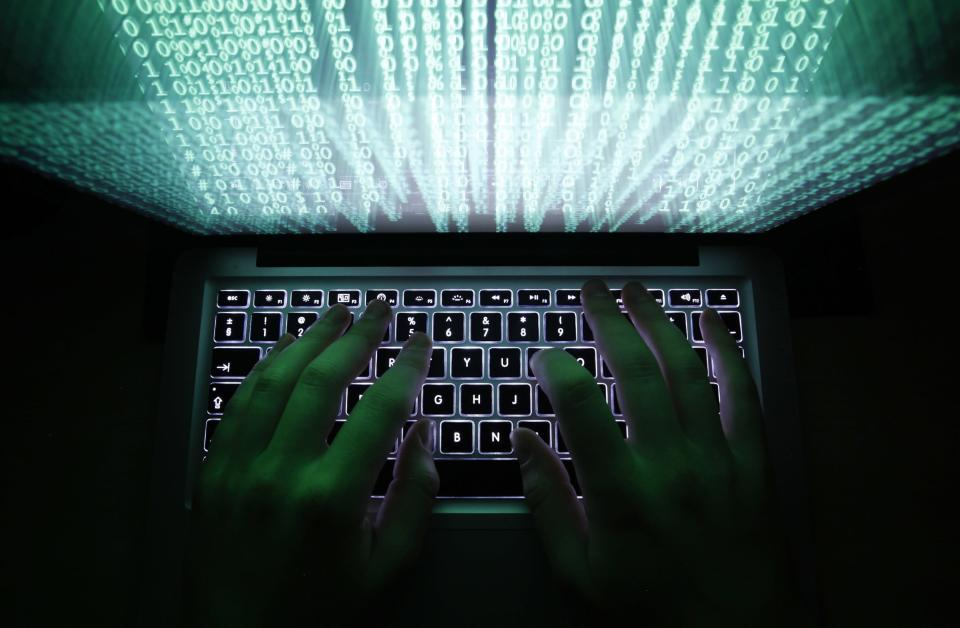 A man types on a computer keyboard in Warsaw in this February 28, 2013 illustration file picture. A barrage of damaging cyberattacks is shaking up the security industry, with some businesses and organisations no longer assuming they can keep hackers at bay, and instead turning to waging a guerrilla war from within their networks. Picture taken February 28, 2013. REUTERS/Kacper Pempel/Files (POLAND - Tags: BUSINESS SCIENCE TECHNOLOGY)