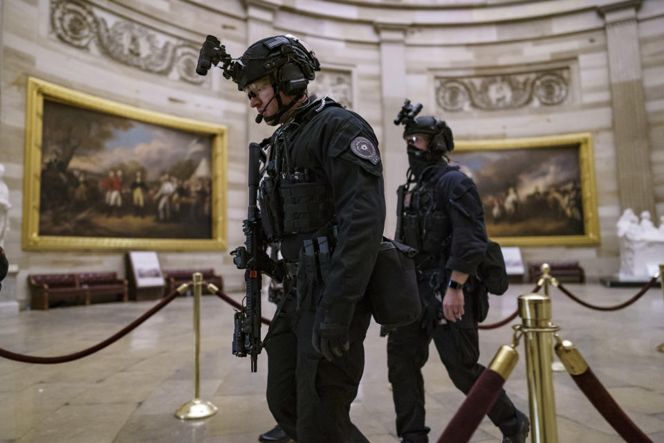 FILE - In this Jan. 6, 2021, file photo, members of the U.S. Secret Service Counter Assault Team walk through the Rotunda as they and other federal police forces responded as violent protesters loyal to then-President Donald Trump stormed the U.S. Capitol in Washington. (AP Photo/J. Scott Applewhite, File)