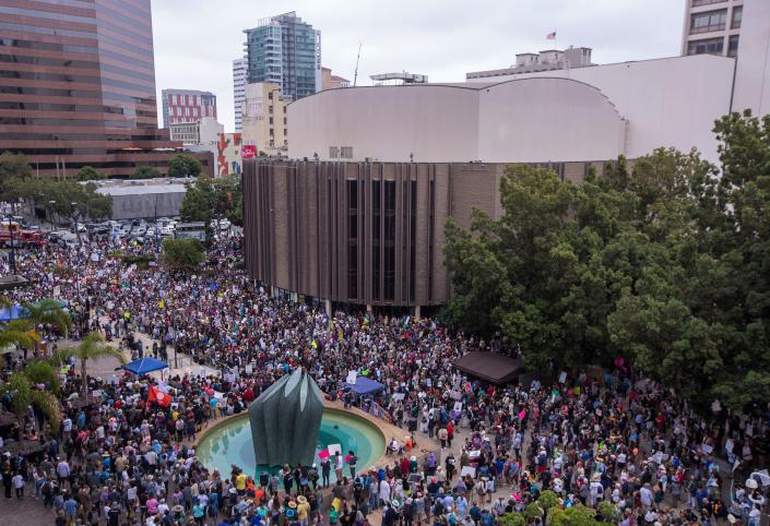<p>People gather at the San Diego Civic Center to demand that thousands of children taken from their immigrant parents by border officials under recent controversial Trump administration policies be reunited on June 23, 2018 in San Diego, Calif. (Photo: David McNew AFP/Getty Images) </p>