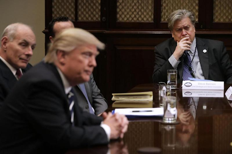 Donald Trump and chief strategist Steve Bannon (right) at a meeting with government cyber security experts (Getty Images)