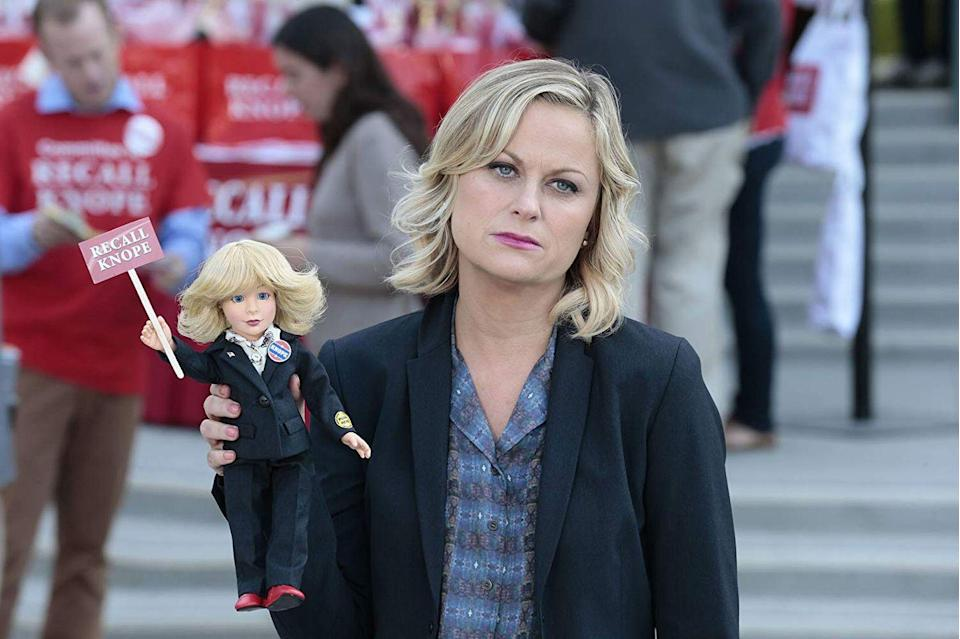 """<p>With comedy legend Amy Poehler involved, you know there's going to be a good time had by all. Poehler plays Leslie Knope, the Deputy Director of the Parks and Recreation Department in a fictional city in Indiana. As she works to turn an abandoned site into a community park, she also deals with government officials blocking her road to success. Through each beautification project, audiences are treated to slap-knee comedy and a lot of waffle eating. </p><p><a class=""""link rapid-noclick-resp"""" href=""""https://www.netflix.com/title/70143842"""" rel=""""nofollow noopener"""" target=""""_blank"""" data-ylk=""""slk:Watch Now"""">Watch Now</a></p>"""