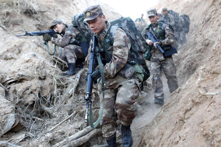Soldiers take part in an exercise in Heihe, northeast China's Heilongjiang province, April 9, 2014