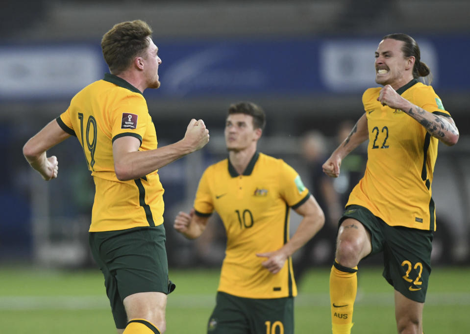 Australia's players celebrate after a goal during the World Cup 2022 Group B qualifying soccer match between Jordan and Australia in Kuwait City, Kuwait, Tuesday, June 15, 2021. (AP Photo/Jaber Abdulkhaleg)