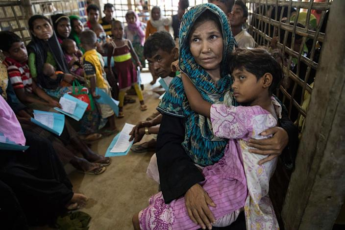 <p>Patients wait for medical treatment in the urgent out patient waiting area at the 'Doctors Without Borders' Kutupalong clinic on October 4, 2017, in Cox's Bazar, Bangladesh. (Photograph by Paula Bronstein/Getty Images) </p>