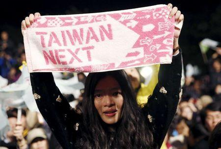 A supporter of Taiwan's Democratic Progressive Party (DPP) Chairperson and presidential candidate Tsai Ing-wen celebrates her victory in Taipei, Taiwan, January 16, 2016. REUTERS/Olivia Harris