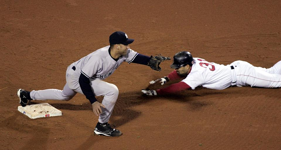 Dave Roberts steals second base as Derek Jeter takes the throw in the 9th inning of Game 4 of the 2004 ALCS. (Getty Images)