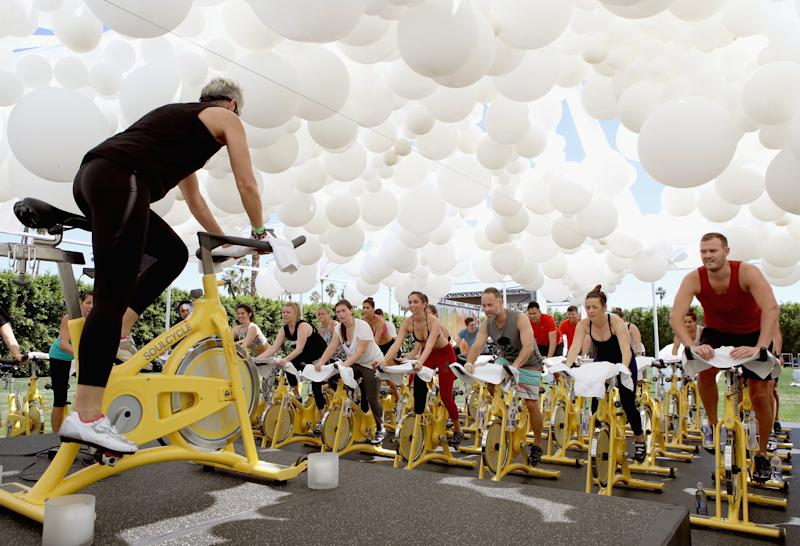 PALM SPRINGS, CA - APRIL 15: Guests workout at the SoulCycle studio at the American Express Platinum House at The Parker Palm Springs on April 14, 2017 in Palm Springs, California. (Photo by Ari Perilstein/Getty Images for American Express)