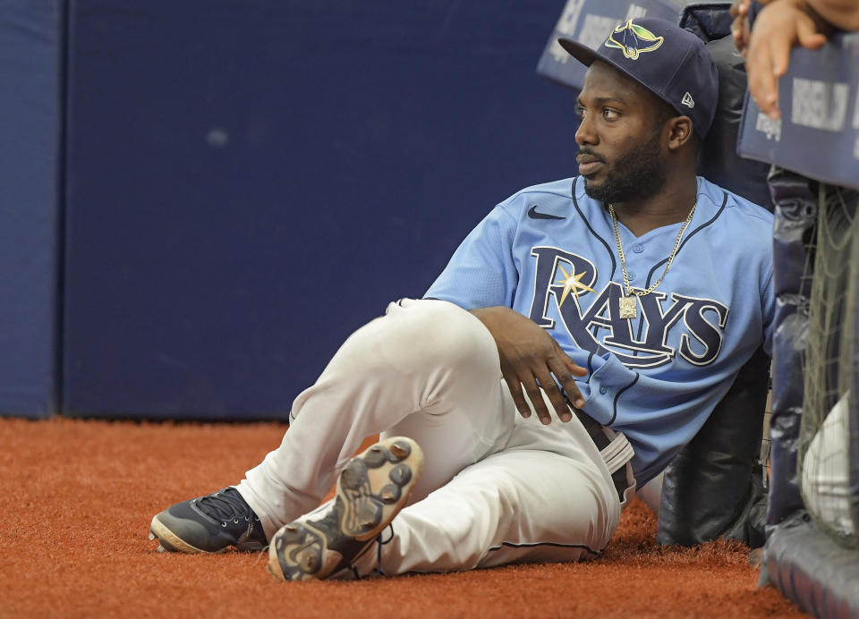 Tampa Bay Rays designated hitter Randy Arozarena watches his team play against the Baltimore Orioles during the ninth inning of a baseball game Sunday, June 13, 2021, in St. Petersburg, Fla. (AP Photo/Steve Nesius)