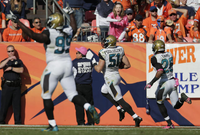 Jacksonville Jaguars middle linebacker Paul Posluszny (51) runs back an interception 59 yards for a touchdown against the Denver Broncos in the second quarter of an NFL football game, Sunday, Oct. 13, 2013, in Denver. (AP Photo/Jack Dempsey)