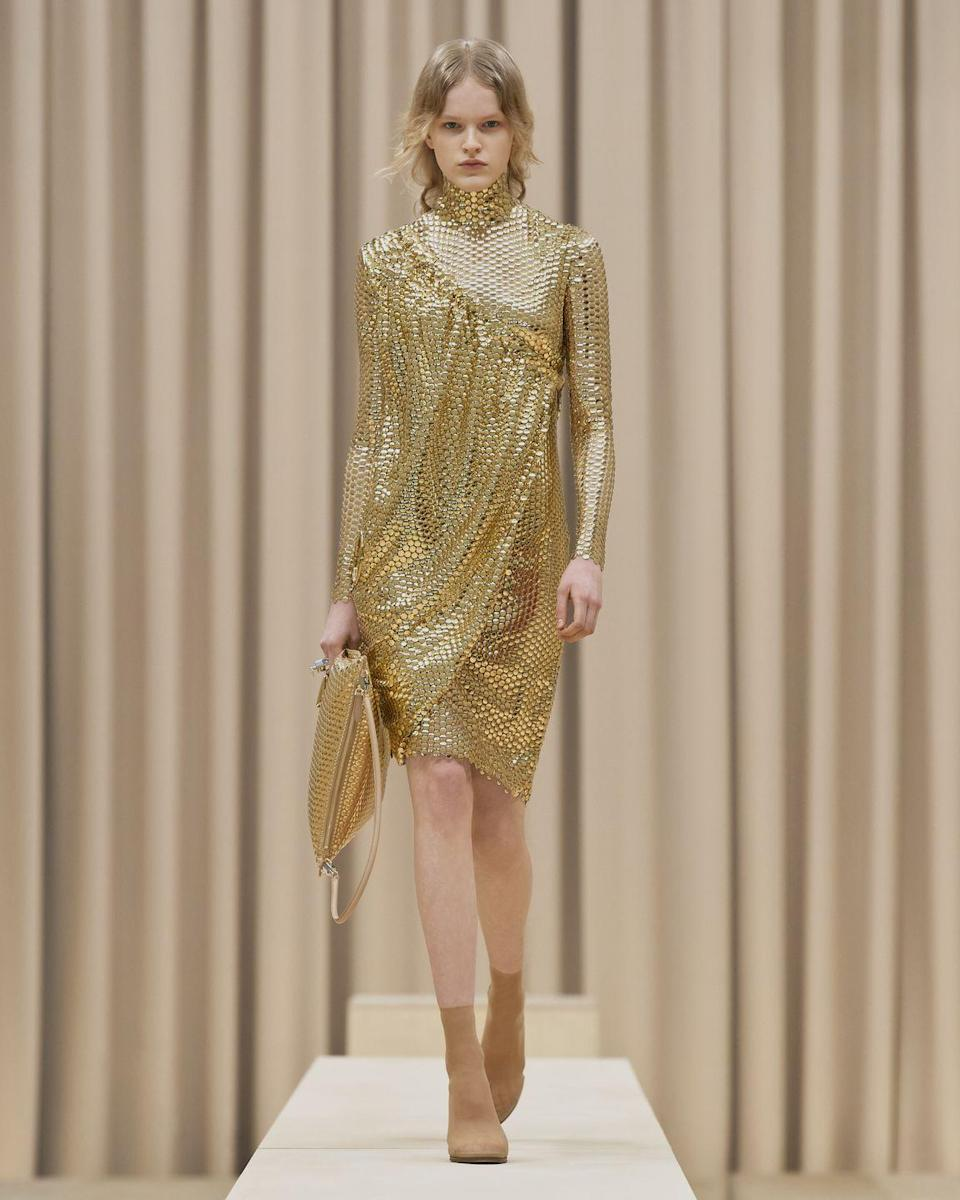 "<p>Riccardo Tisci's autumn/winter 2021 womenswear presentation was a love letter to strong women - those ""warriors"" who aren't afraid to ""challenge expectations"".</p><p>""I wanted this collection to feel truly emblematic of the power of feminine energy: a modern armour that captures its characteristic fierce aura,"" explained Tisci. ""There's an underlying attitude to the collection that's very British; of being unique, eccentric and totally authentic in how you express yourself.""</p><p>This resulted in signature Burberry pieces given a creative, unexpected twist in a more abstract offering than we've seen from the creative director since joining the British heritage house. </p>"