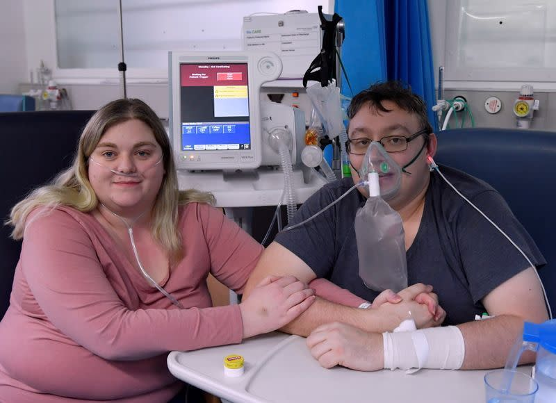 Lizzie Kerr, 31, and Simon O'Brien, 36, in a COVID-19 ward in Milton Keynes University Hospital (Reuters)