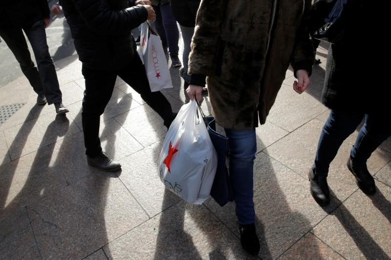 People carry shopping bags outside Macy's Herald Square in Manhattan, New York City