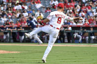 Los Angeles Angels third baseman Jack Mayfield throws to first base on an infield hit by Seattle Mariners' Kyle Seager during the eighth inning of a baseball game, Sunday, Sept. 26, 2021, in Anaheim, Calif. (AP Photo/Michael Owen Baker)