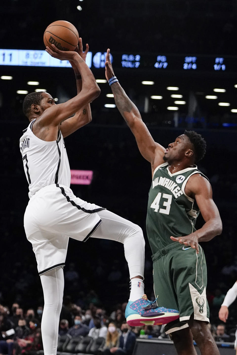 Brooklyn Nets' Kevin Durant (7) shoots over Milwaukee Bucks' Thanasis Antetokounmpo (43) during the first half of a preseason NBA basketball game Friday, Oct. 8, 2021, in New York. (AP Photo/Frank Franklin II)