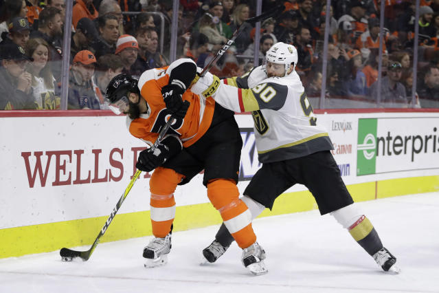 Vegas Golden Knights' Tomas Tatar, right, and Philadelphia Flyers' Radko Gudas battle for the puck during the third period of an NHL hockey game, Monday, March 12, 2018, in Philadelphia. (AP Photo/Matt Slocum)