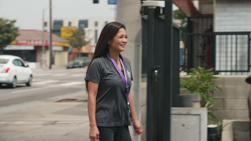 Yvette Enrique walking to the Asian American Drug Abuse Prevention office. (Photo: HuffPost / Shirley Chan)