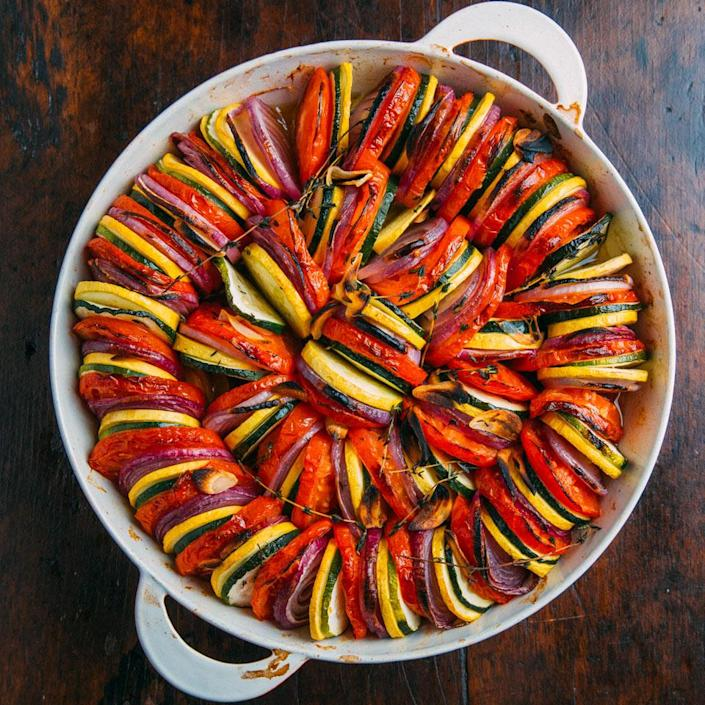 <p>This pretty vegan layered casserole is so simple to make. Its only seasonings are salt and garlic-infused olive oil, which you make by sizzling a clove of garlic in olive oil for about a minute. This dish is lovely warm or room temperature. Serve with crusty bread as a vegetarian entree or alongside roasted meats as a side dish--don't forget a glass of chilled rosé.</p>