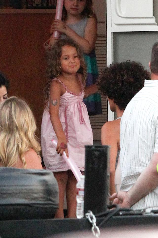 Nahla kept busy hanging out in the Bond babe's trailer with a friend. The cute kid will soon have a new family member when Halle and her fiance Olivier Martinez tie the knot. The pair is rumored to be planning a South African wedding. (7/19/2012)