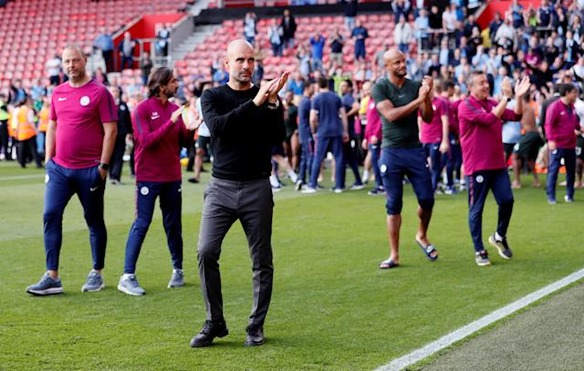 "Soccer Football - Premier League - Southampton vs Manchester City - St Mary's Stadium, Southampton, Britain - May 13, 2018 Manchester City manager Pep Guardiola applauds fans after the match REUTERS/David Klein EDITORIAL USE ONLY. No use with unauthorized audio, video, data, fixture lists, club/league logos or ""live"" services. Online in-match use limited to 75 images, no video emulation. No use in betting, games or single club/league/player publications. Please contact your account representative for further details."