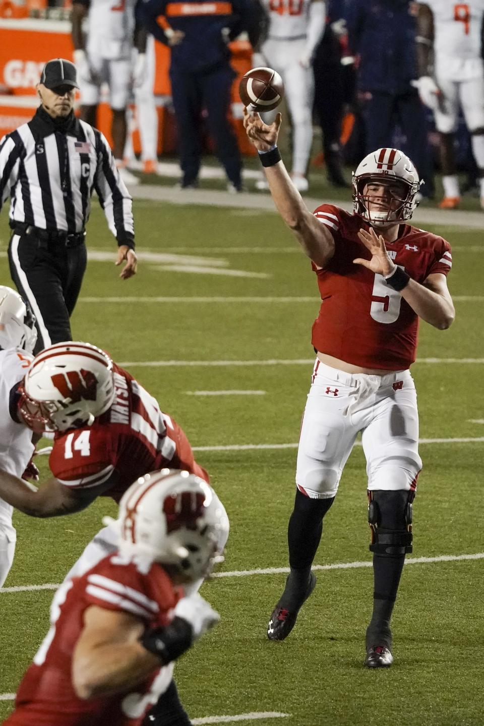 Wisconsin quarterback Graham Mertze throws a touchdown pass to Wisconsin's Mason Stokke during the first half of an NCAA college football game against Illinois Friday, Oct. 23, 2020, in Madison, Wis. (AP Photo/Morry Gash)