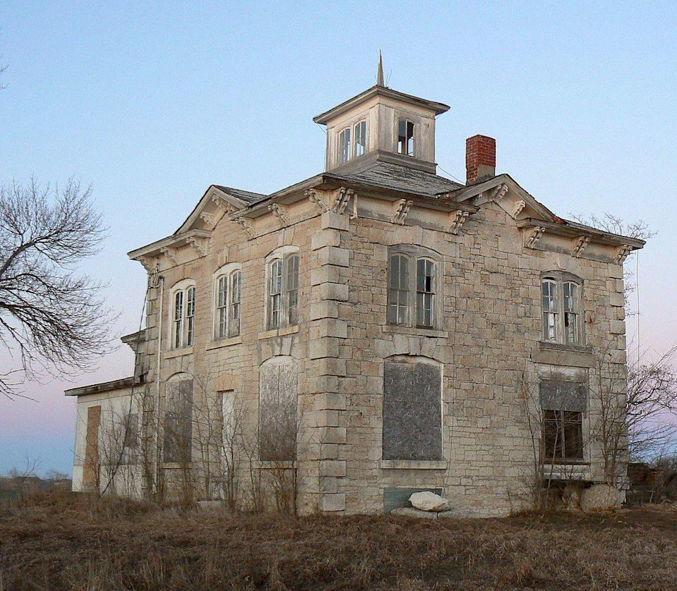"""<p><strong>Israel Beetison House - Ashland, NE</strong></p><p>Added to the National Register of Historic Places in 1977, the Israel Beetison house in Ashland was built in 1874. <a href=""""https://journalstar.com/news/local/epilogue-historical-beetison-house-sits-empty/article_28ed0c19-86f3-5f85-9bda-795dc448640e.html"""" rel=""""nofollow noopener"""" target=""""_blank"""" data-ylk=""""slk:Five generations of the same family"""" class=""""link rapid-noclick-resp"""">Five generations of the same family</a> lived in the house until it was sold in 1999. Nature has reclaimed much of the Italian styled building, which has sat abandoned for over a decade–making it the perfect destination for urban explorers and paranormal enthusiasts alike.</p><p> Photo: Wikimedia Commons/<a href=""""https://en.wikipedia.org/wiki/Israel_Beetison_House#/media/File:School_58_Saunders_County_Nebraska.jpg"""" rel=""""nofollow noopener"""" target=""""_blank"""" data-ylk=""""slk:Mongo"""" class=""""link rapid-noclick-resp"""">Mongo</a> </p>"""