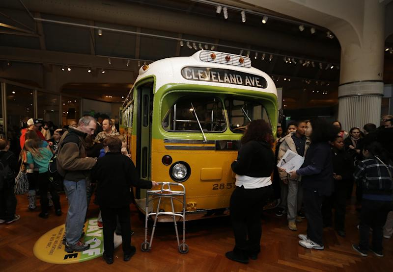 Visitors to The Henry Ford museum in Dearborn, Mich., wait to board the Rosa Parks bus, Monday, Feb. 4, 2013. Earlier in the day the Rosa Parks' 100th birthday commemorative postage stamp was unveiled at the museum.(AP Photo/Carlos Osorio)