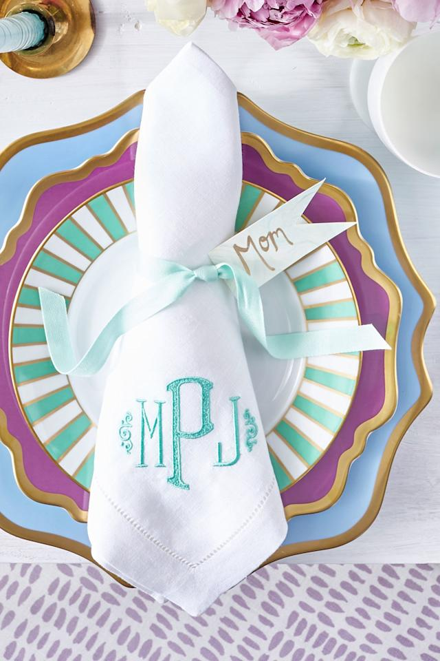 """<p>This is another easy napkin fold that prominently places <a href=""""https://www.southernliving.com/home-garden/decorating/monogrammed-napkins"""">your monogrammed or embroidered linens</a> on display. You can add a ribbon or ring to add some volume to your napkins, or they can be folded flat and placed under the top plate or bowl at each setting, leaving just the monogram visible.</p> <p>To do it: Simply fold your napkin into square quarters, and then orient the napkin so the monogrammed corner is facing you. Fold the left and right sides under the napkin evenly, creating a narrower point at the top.</p>"""