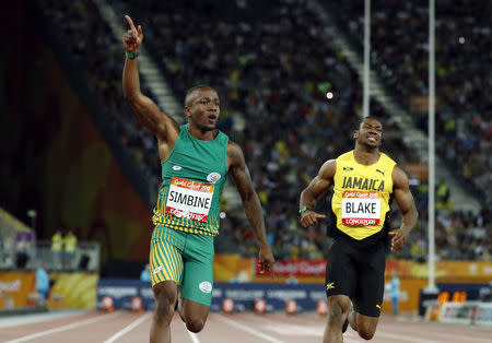 Athletics - Gold Coast 2018 Commonwealth Games - Men's 100m Final - Carrara Stadium - Gold Coast, Australia - April 9, 2018. Akani Simbine of South Africa and Yohan Blake of Jamaica. REUTERS/Jeremy Lee