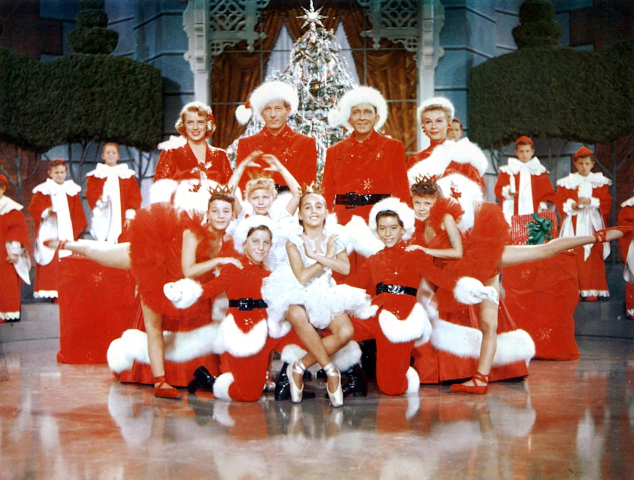 """<p>Each year, you hear Bing Crosby crooning on the radio, so why not watch him in his wonderfully lavish Christmas rom-com musical? In <strong>White Christmas</strong>, two war buddies turned successful producers fall for a pair of sisters. One day, they stay at their former commanding officer's lodge and learn that it's about to close, so they set out to do a special performance in order to save it.</p> <p><a href=""""http://www.netflix.com/title/60003082"""" target=""""_blank"""" class=""""ga-track"""" data-ga-category=""""Related"""" data-ga-label=""""http://www.netflix.com/title/60003082"""" data-ga-action=""""In-Line Links"""">Watch <b>White Christmas</b> on Netflix</a>.</p>"""