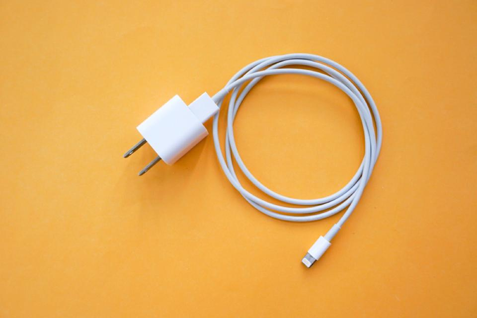 iphone charger on an orange background