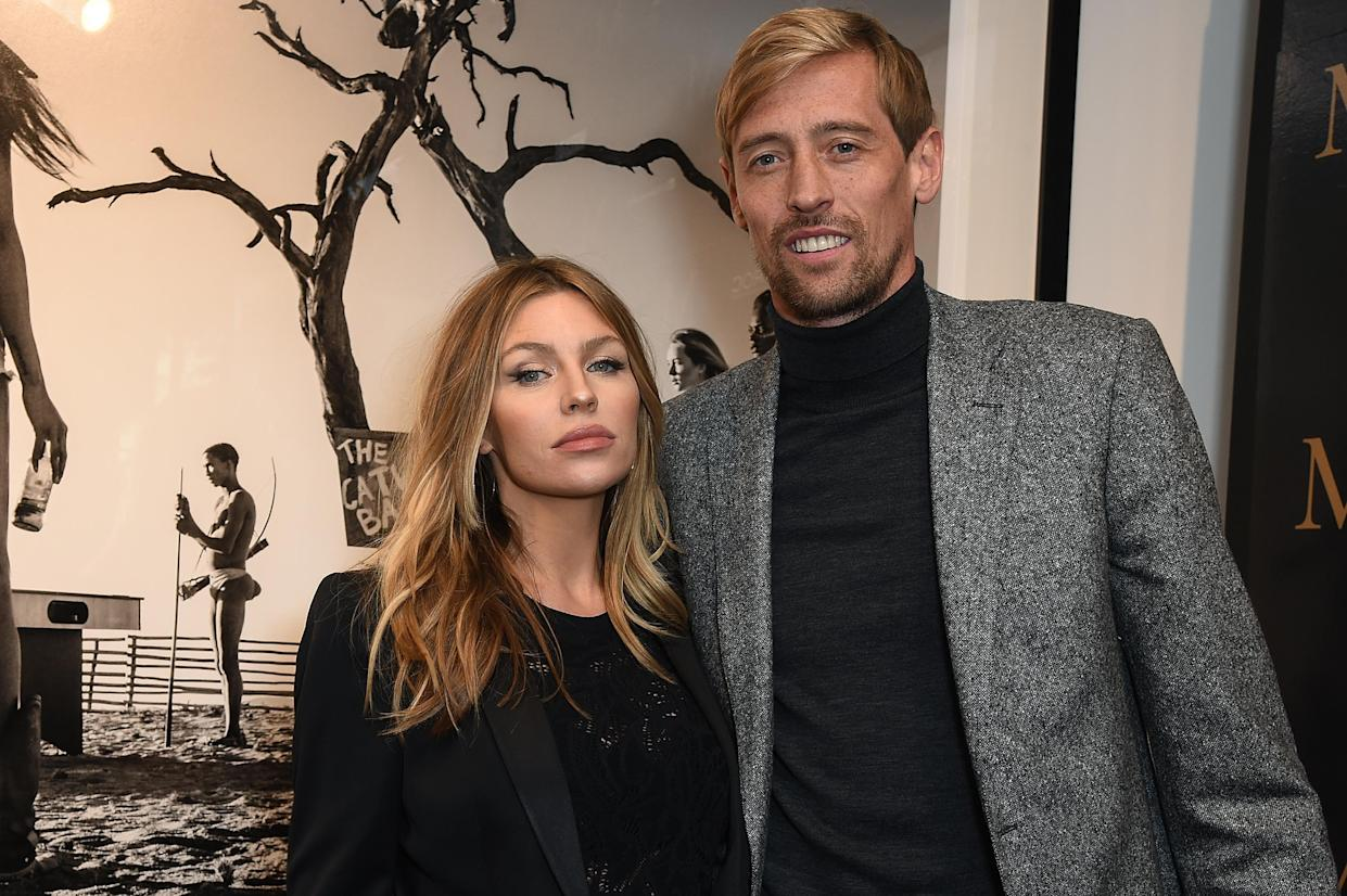 LONDON, ENGLAND - SEPTEMBER 14:  Abbey Clancy (L) and Peter Crouch attend the private view of leading wildlife photographer, David Yarrow's exhibition at Maddox Gallery Westbourne Grove, in association with CIROC, Rolls Royce and VICTOR on September 14, 2017 in London, England.  (Photo by David M. Benett/Dave Benett/Getty Images for Maddox Gallery)