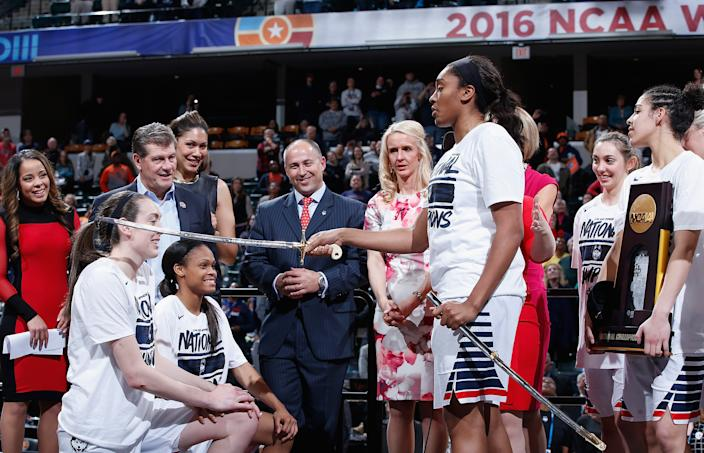 INDIANAPOLIS, IN - APRIL 05:  Breanna Stewart #30 and Moriah Jefferson #4 of the Connecticut Huskies are honored by teammate Morgan Tuck #3 of the Connecticut Huskies as head coach Geno Auriemma looks on after their 82-51 victory over the Syracuse Orange to win the 2016 NCAA Women's Final Four Basketball Championship at Bankers Life Fieldhouse on April 5, 2016 in Indianapolis, Indiana.  (Photo by Joe Robbins/Getty Images)