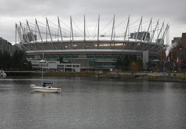 VANCOUVER, CANADA - NOVEMBER 27: A boat sits idle in False Creek in front of BC Place where the 99th Grey Cup between the Winnipeg Blue Bombers and the BC Lions is being played November 27, 2011 in Vancouver, British Columbia, Canada. (Photo by Jeff Vinnick/Getty Images)
