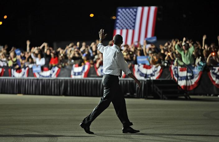 President Barack Obama waves to supporters following the conclusion of a campaign event before his departure on Air Force One at Cleveland Burke Lakefront Airport, Thursday, Oct. 25, 2012, in Cleveland. (AP Photo/Pablo Martinez Monsivais)