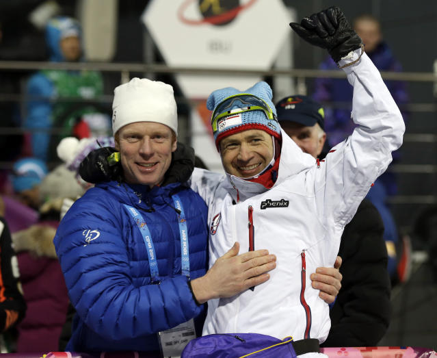 Norway's Ole Einar Bjoerndalen, right, celebrates with former cross-country skier Bjoern Daehlie after winning the gold medal in the men's biathlon 10k sprint, at the 2014 Winter Olympics, Saturday, Feb. 8, 2014, in Krasnaya Polyana, Russia. (AP Photo/Lee Jin-man)