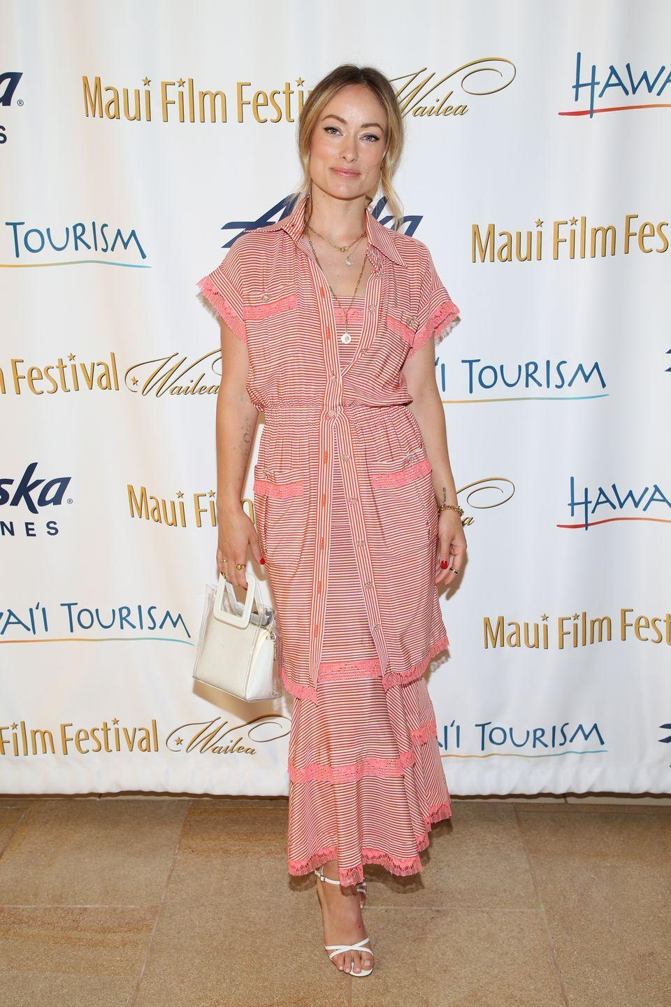 <p>Wilde went for a summery coral-coloured Chanel SS19<br> dress and a white Staud 'Mini Shirley' bag and Schutz 'Marnie' sandals for the festival. <br></p>