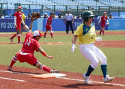 Japan's Minori Naito, left, reacts after getting Australia's Stacey McManus out during the softball game between Japan and Australia at the 2020 Summer Olympics, Wednesday, July 21, 2021, in Fukushima , Japan. (AP Photo/Jae C. Hong)