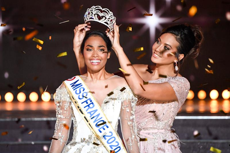 Newly elected Miss France 2020, Miss Guadeloupe Clemence Botino (L), is crowned by Miss France 2019 Vaimalama Chaves at the end of the Miss France 2020 beauty contest in Marseille, on December 14, 2019. (Photo by CHRISTOPHE SIMON / AFP) / RESTRICTED TO EDITORIAL USE - NO MARKETING - NO ADVERTISING CAMPAIGNS (Photo by CHRISTOPHE SIMON/AFP via Getty Images)