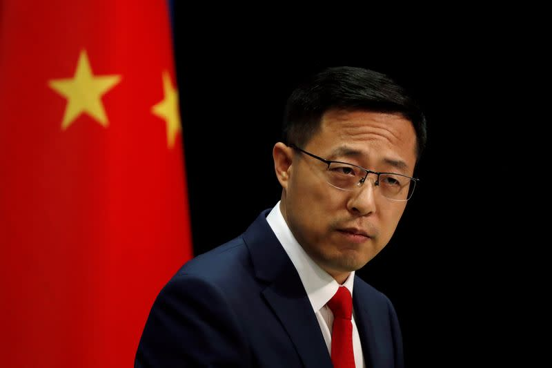 Chinese Foreign Ministry spokesman Zhao Lijian attends a news conference in Beijing, China