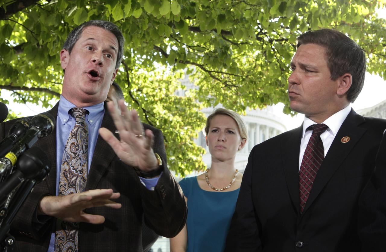 "Senator David Vitter (R-LA) (L) and Representative Ron DeSantis (R-FL) hold a news conference on Capitol Hill in Washington to ""urge House Republicans to include the 'No Washington Exemption from Obamacare' amendment in the Continuing Resolution"" September 30, 2013. Democrats who control the U.S. Senate were confident that they would defeat Republicans' efforts to delay ""Obamacare"" health reforms on Monday and send a ""clean"" bill to keep the federal government operating back to the House of Representatives. REUTERS/Yuri Gripas (UNITED STATES - Tags: POLITICS BUSINESS)"