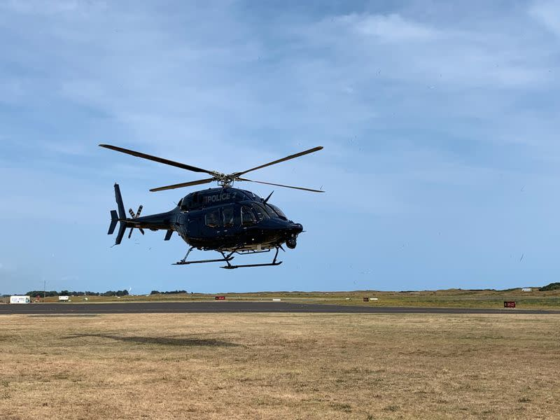 A New Zealand Police helicopter returns to Whakatane after conducting a search for bodies in the aftermath of the eruption of White Island volcano