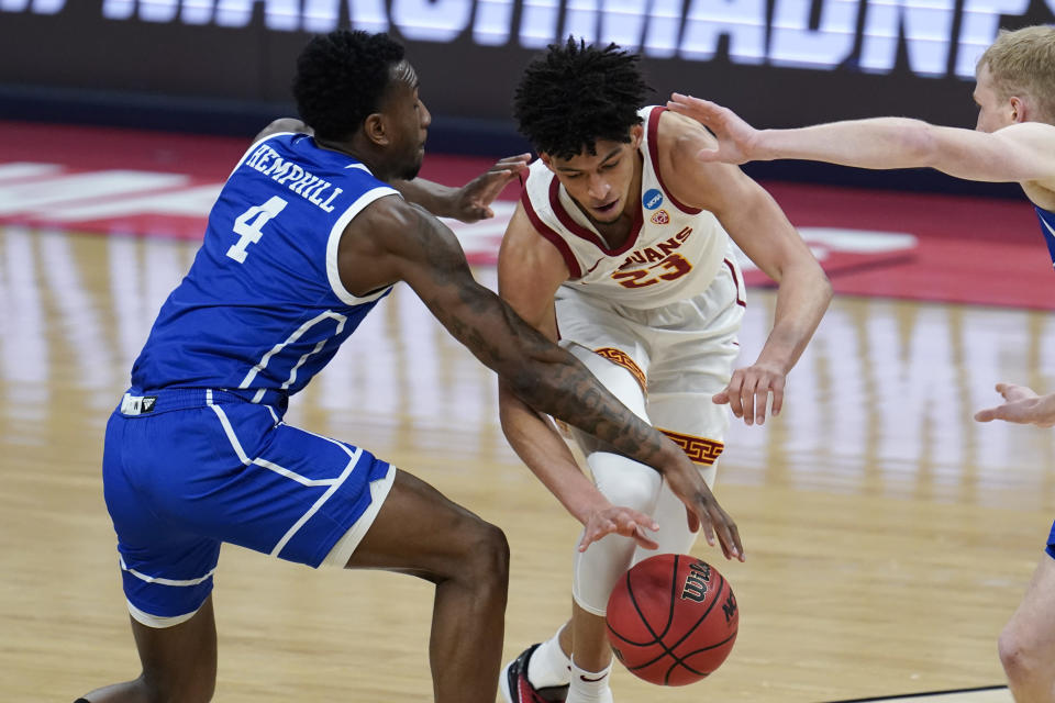 USC forward Max Agbonkpolo (23) drives on Drake forward ShanQuan Hemphill (4) during the first half of a men's college basketball game in the first round of the NCAA tournament at Bankers Life Fieldhouse in Indianapolis, Saturday, March 20, 2021. (AP Photo/Paul Sancya)