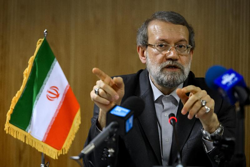 Iran's parliament speaker Ali Larijani gestures during a press conference on the sideline of the an International Parliamentary Union assembly on October 9, 2013 in Geneva (AFP Photo/Fabrice Coffrini)