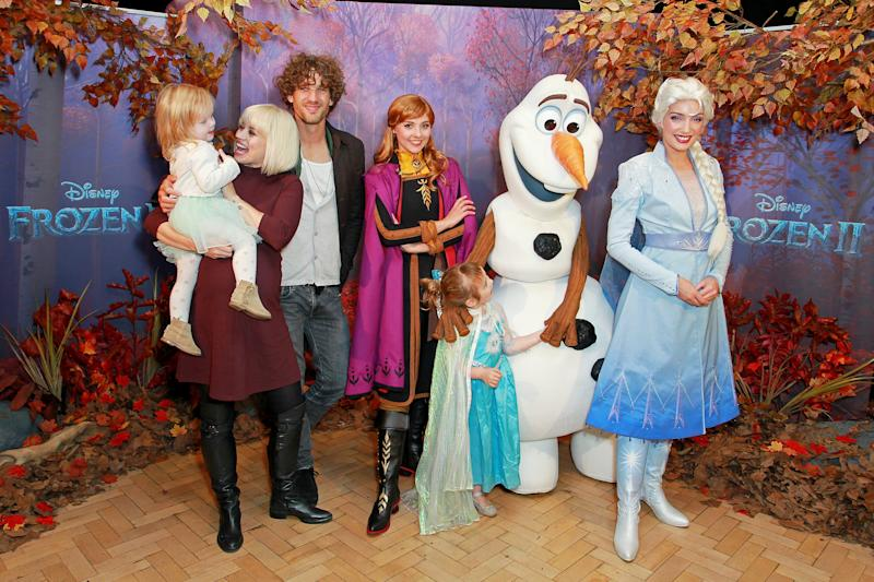 LONDON, ENGLAND - OCTOBER 02: (L-R) Willow Rogers, Kimberly Wyatt, Max Rogers and Maple Rogers with characters Anna, Olaf and Elsa attend the star-studded launch of the new Frozen 2 merchandise, ahead of the film's release next month on October 02, 2019 in London, England. (Photo by David M. Benett/Dave Benett/Getty Images for Disney)