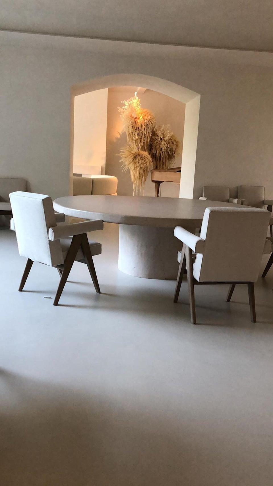 """Past views of this room depicted a<a href=""""https://people.com/home/kim-kardashian-kanye-west-photos-inside-home/?slide=6925610#6925610"""" rel=""""nofollow noopener"""" target=""""_blank"""" data-ylk=""""slk:headless mannequin in an empty hallway"""" class=""""link rapid-noclick-resp""""> headless mannequin in an empty hallway</a>, so it's nice to see the family add a fun and playful touch by adding neutral branches."""
