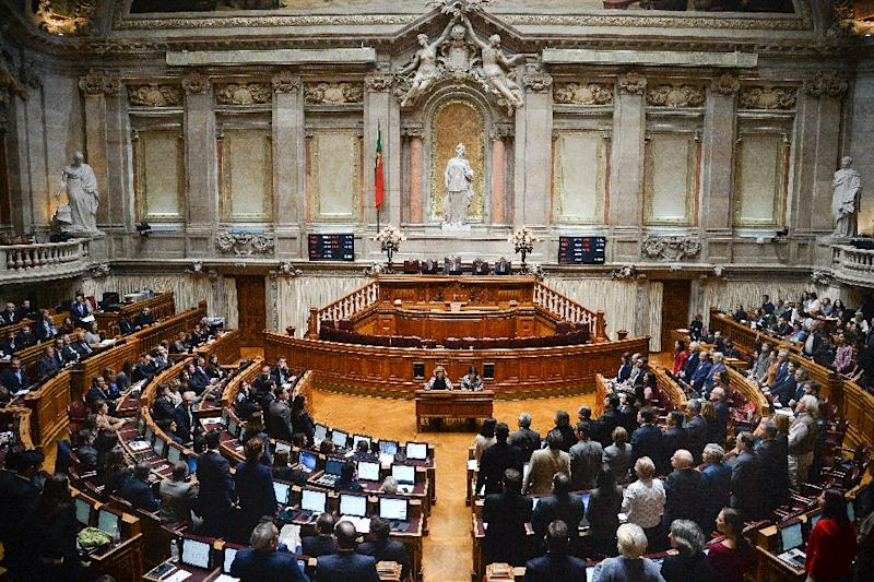 Portuguese members of parliament vote during a session where four bills giving couples -- including unmarried and same-sex couples -- full rights to adoption have been approved, in Lisbon on November 20, 2015 (AFP Photo/Patricia De Melo Moreira)